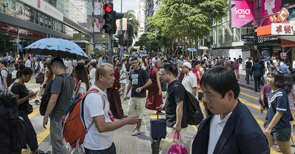 Crowd of people crossing the road in Hong Kong