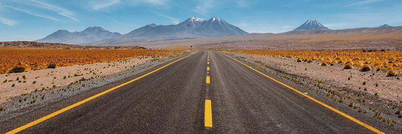Paved road through desert mountain landscape