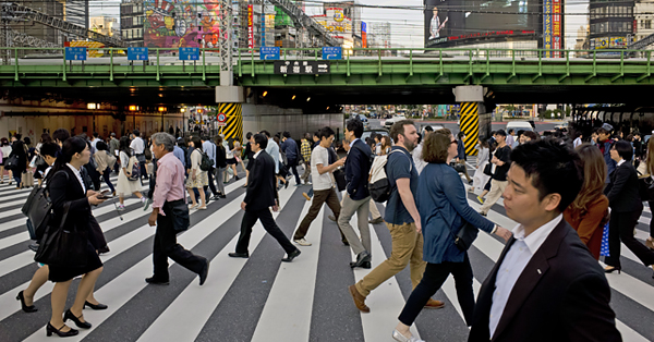 People crossing a busy intersection in Shinjuku, Tokyo